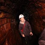 Boy in mine tunnel