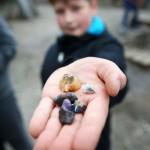 Child holding stones