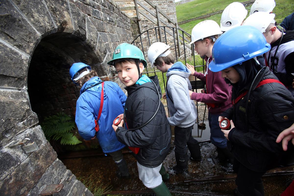 Kids entering the mine