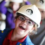 Young school girl with her Killhope mining helmet on
