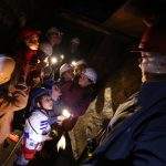 Children in the Killhope mine with a guide